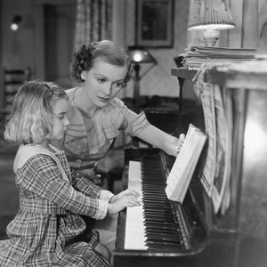 a piano teacher and a student